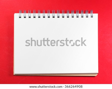 Top view of white blank note on red background