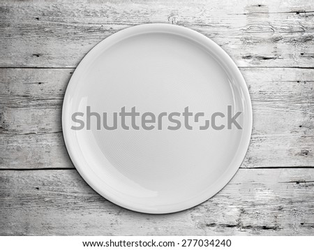 Top view of white empty plate - stock photo