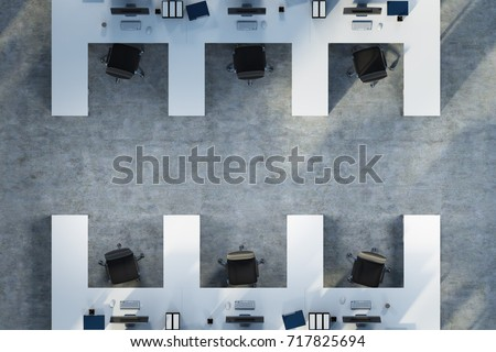 top view of white table office cubicles with computers and folders on the desks a