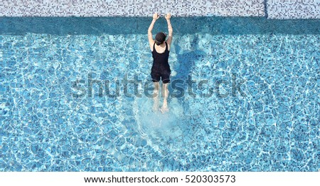 Top view of woman at swimming pool.