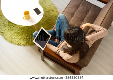 Top view of woman look at the digital tablet at home - stock photo