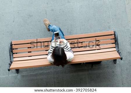 Top view of woman use of mobile phone - stock photo