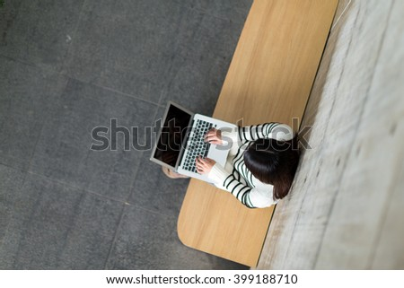 Top view of woman use of notebook computer