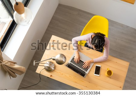 Top view of woman use of noteebook computer at home - stock photo