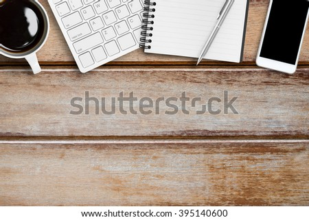 Top view of wood office table with supplies. Copy space is available. - stock photo
