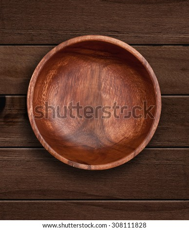 Top view of wooden bowl on  wooden background