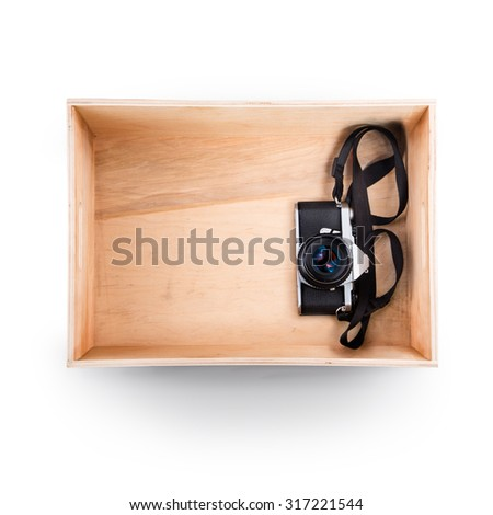 Top view of wooden box. Old camera inside - stock photo