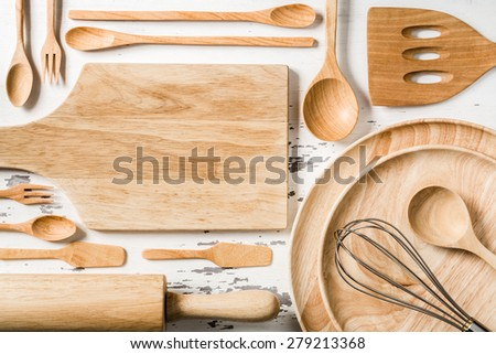 Top view of wooden kitchen utensils on wood board - stock photo