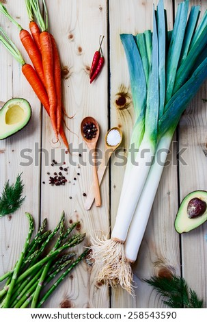 Top view of wooden spoon and fresh vegetables. Vegetarian food, health or cooking concept. - stock photo