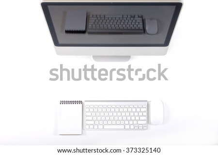 Top View of Working Place of Designer with large Computer Monitor Keyboard Notepad and Mouse on White Desk with Gadgets Reflection on Screen - stock photo
