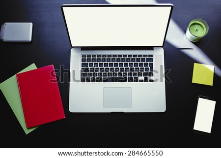 Top view of workplace with open laptop, colorful notebooks and stickers, computer with blank copy space screen for your information or content, modern table at window in home interior, distance work - stock photo