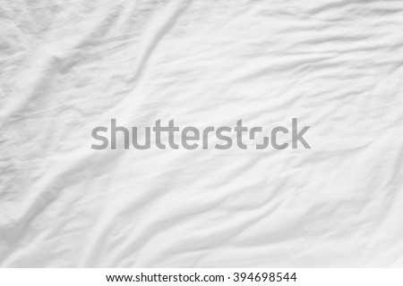 Top view of wrinkles fabric sheet unmade bed - stock photo