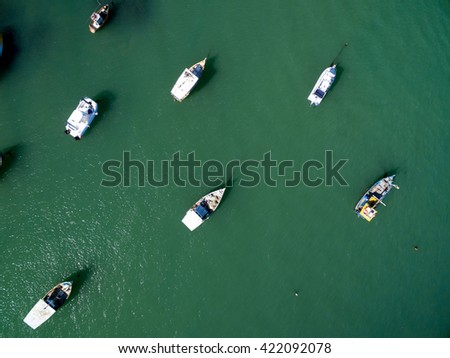 Top View of Yacht sailing in open sea at sunny day - stock photo