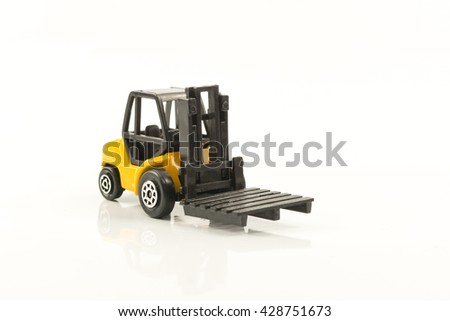 top view of yellow forklift isolated on white background,toy