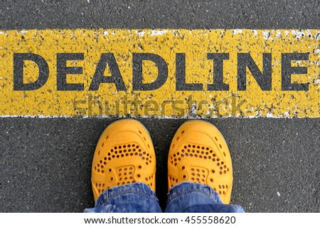 Top View of yellow shoes on the asphalt road with yellow line. Go to deadline
