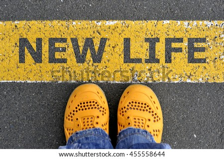 Top View of yellow shoes on the asphalt road with yellow line. Go to new life.