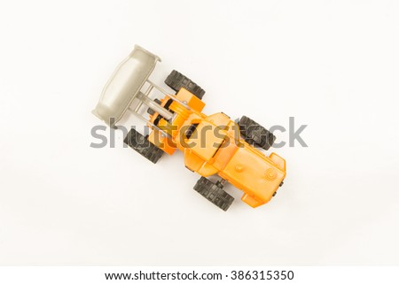 top view of yellow wheel loader isolated on white background,toy - stock photo