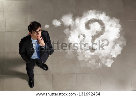 Top view of young businessman making decision - stock photo