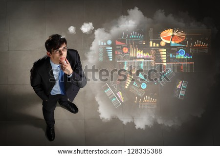 Top view of young businessman making decision diagram in air - stock photo