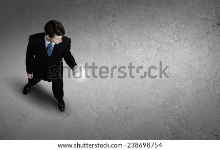 Top view of young businessman using mobile phone