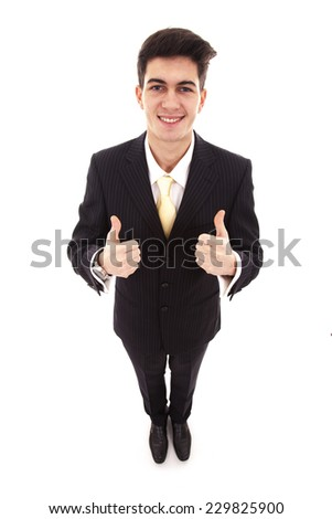 Top view of young businessman with two thumbs up on white background  - stock photo