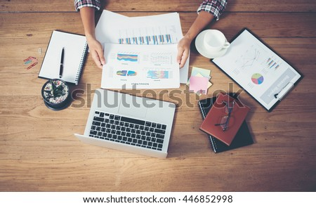 Top view of young  Businessman woman hands reviewing analyzing financial data chart.  - stock photo