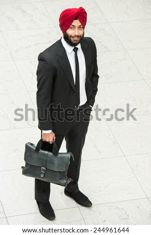 Top view of young indian businessman in red turban. - stock photo