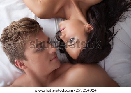 Top view of young lovers looking at each other - stock photo