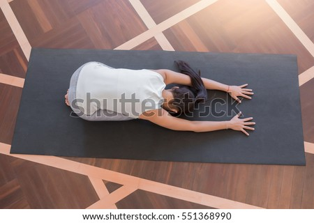Top View Of Young Woman Doing Yoga Childs Pose Resting Stretching Yogi Workout