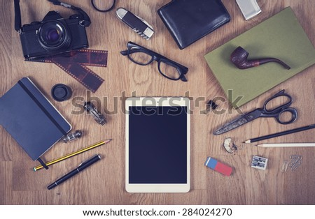 Top view office desk with tablet pc hero header - stock photo