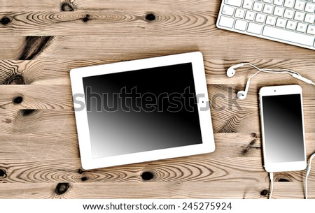 Top View Office Workplace with Keyboard, Tablet PC, Phone - stock photo