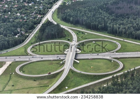 Top view on a big traffic intersection - stock photo