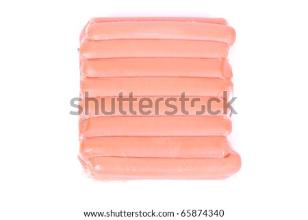 Top view on a pack of shrink-wrapped chicken sausages. Image isolated on white studio background. - stock photo