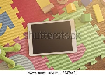 top view on a tablet device on a children'??s?s playground, digital gaming concept