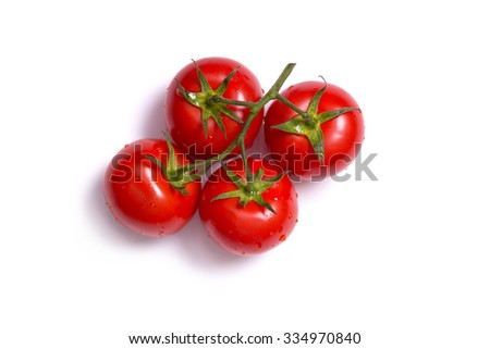 Top view on bunch of fresh tomatoes, isolated on white background