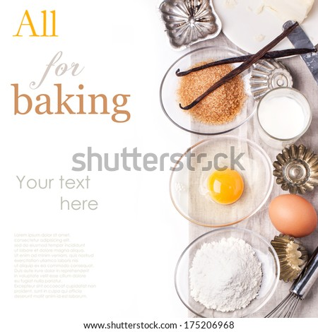 Top view on ingredients for baking (flour, egg, brown sugar) with vintage cupcake's forms over white with sample text - stock photo