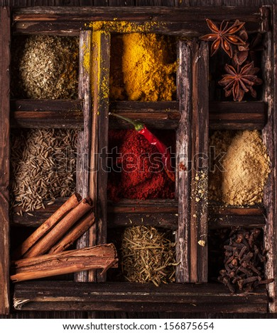 Top view on mix of spices in old wooden box - stock photo