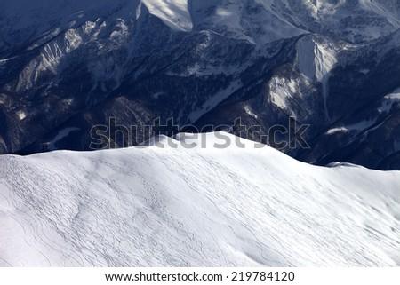 Top view on off piste slope in evening. Caucasus Mountains, Georgia, ski resort Gudauri. - stock photo