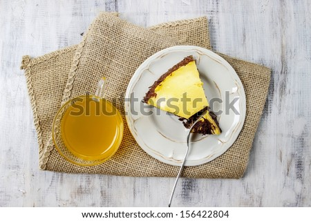 Top view on piece of cake on wooden table - stock photo
