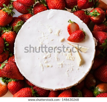 top view on strawberry cheesecake with fresh strawberries  - stock photo