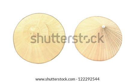 Top view on two different styles of farmer palm hats isolated on white background - stock photo