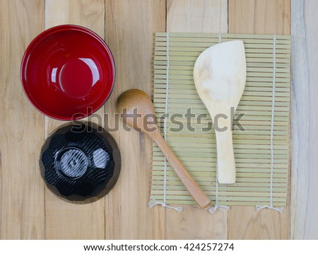 Top view on wooden table with Japanese wooden spoon, and bowl - stock photo