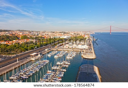 top view on yachts and the bridge 25 Arpels in Lisbon, Portugal - stock photo