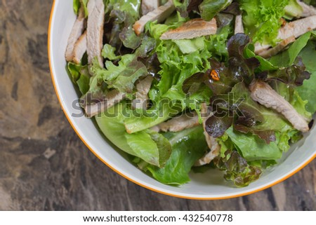 Top view Organic vegetable salad and roasted pork - stock photo
