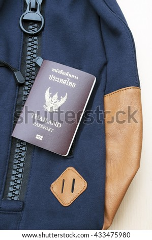 top view passport on backpack for travel , thai passport