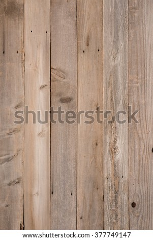 Top View Photo of Naturally Aged, Rough textured Rustic dull Brown Cedar Wood Boards for Backgrounds and Templates with Blank Room or Space for your Design, Words, Text or Copy.  Vertical rectangle