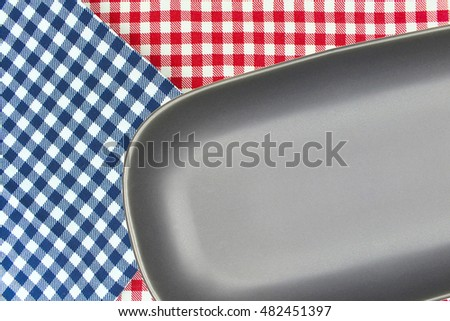 Top view plate on checkered tablecloth pattern background .Free space for products and for your text