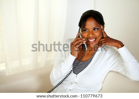 Top view portrait of a charming relaxed woman speaking on phone