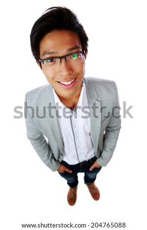 Top view portrait of a cheerful asian man isolated on a white background - stock photo