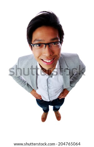 Top view portrait of a smiling asian man isolated on a white background - stock photo